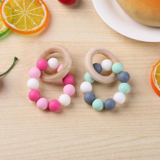 Infant Silicone Chew Nursing Bracelet for Baby Wooden Teethers Baby Rattle Stroller Accessories Toys 5